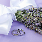 Platinum wedding rings with lavendar wedding bouquet