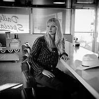 Girl at counter in Restaurant,Flagstaff,Arizona,USA<br /> Model release