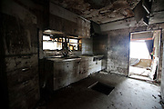 A kitchen of a ruined house is covered with mud which was washed away by the tsunami in Ishinomaki city.