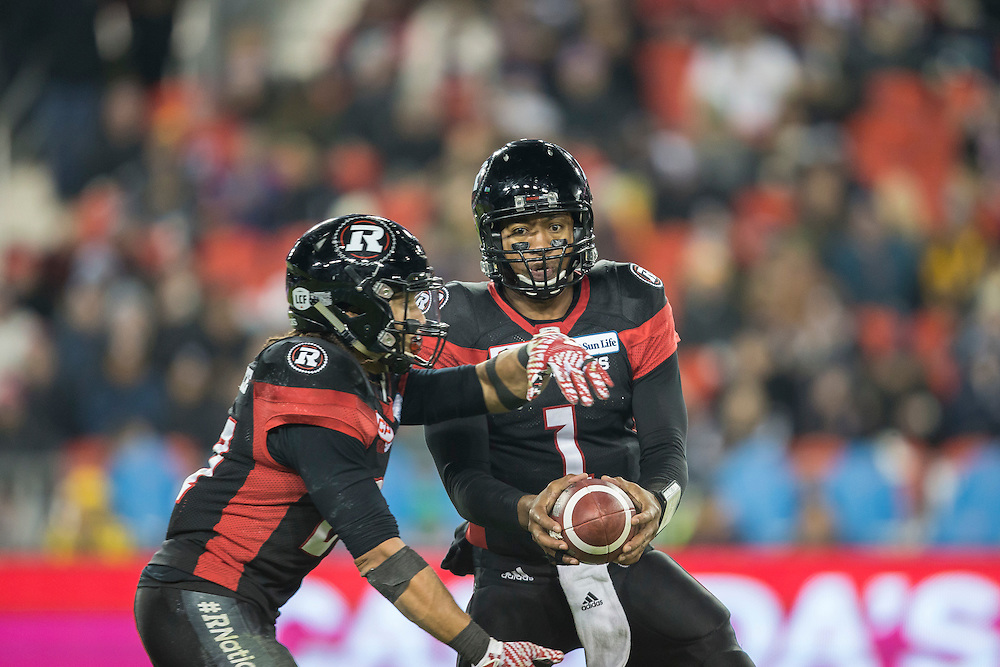 Ottawa Redblacks quarterback Henry Burris hands off to Kienan Lafrance during the 3rd quarter of the 104th Grey Cup Final game against the Calgary Stampeders in Toronto Ontario, Sunday,  November 27, 2016.  (CFL PHOTO - Geoff Robins)