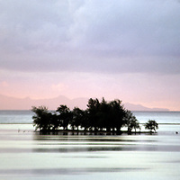 Oceania, South Pacific, French Polynesia, Tahiti. A tiny islet hosts a refuge for birds but not much else.