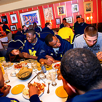 ANN ARBOR, MICHIGAN -- February 2, 2013 -- The University of Michigan basketball team eats an Italian dinner together before loading on the team plane to head to Bloomington to face the Indiana Hoosiers.   (PHOTO / CHIP LITHERLAND)