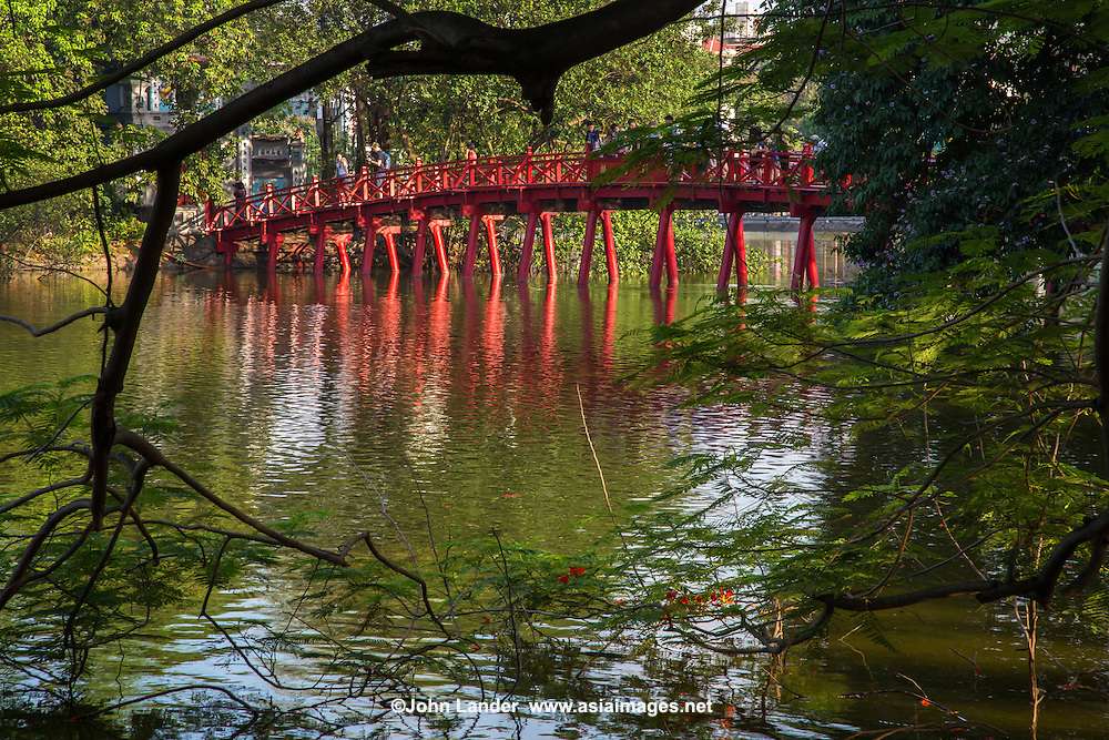 "Huc Bridge or ""bridge where light is absorbed"" over Hoan Kiem Lake or the Lake of the Returned Sword is located in the historical center of Hanoi.  The lake is one of the major scenic spots in the city and also serves as the center for its public life."
