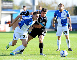 Billy Bodin of Bristol Rovers is held by Portsmouth's Enda Stevens - Mandatory byline: Neil Brookman/JMP - 07966 386802 - 26/09/2015 - FOOTBALL - Memorial Stadium - Bristol, England - Bristol Rovers v Portsmouth - Sky Bet League Two