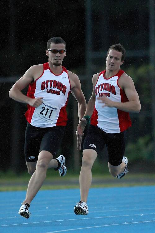 (Ottawa, Ontario---20080620) Jon Dunkerly (ON-OTTL) guided by Sean Young (ON-OTTL)\ competing in the 400m at Supermeet I, the 2008 Ontario Track and Field Association (OTFA) Junior/Senior Track and Field Championships. This image is copyright Sean W. Burges, and the photographer can be contacted at seanburges@yahoo.com.