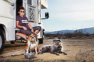 A pair of dogs, Buhhda and Ernie, sit outside their motorhome while camping in the Anza Borrego State Park, California.