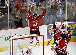 April 28, 2007; East Rutherford, NJ, USA; New Jersey Devils Brian Gionta celebrates a Devils goal in the first period of game two of the 2007 NHL Eastern Conference semi-finals at Continental Airlines Arena in East Rutherford, NJ. The New Jersey Devils won 3-2 in the second overtime to even the series 1-1.