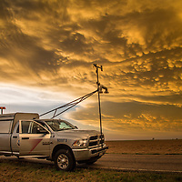 "Storm research vehicle ""Scout 3"" parked under mammatus clouds, May 24, 2016, near Dodge City, Kansas.  Scout 3 is a vehicle working with Project TWIRL, a research mission to place atmospheric measurement probes in front of tornadoes that are being actively scanned by Doppler radar."