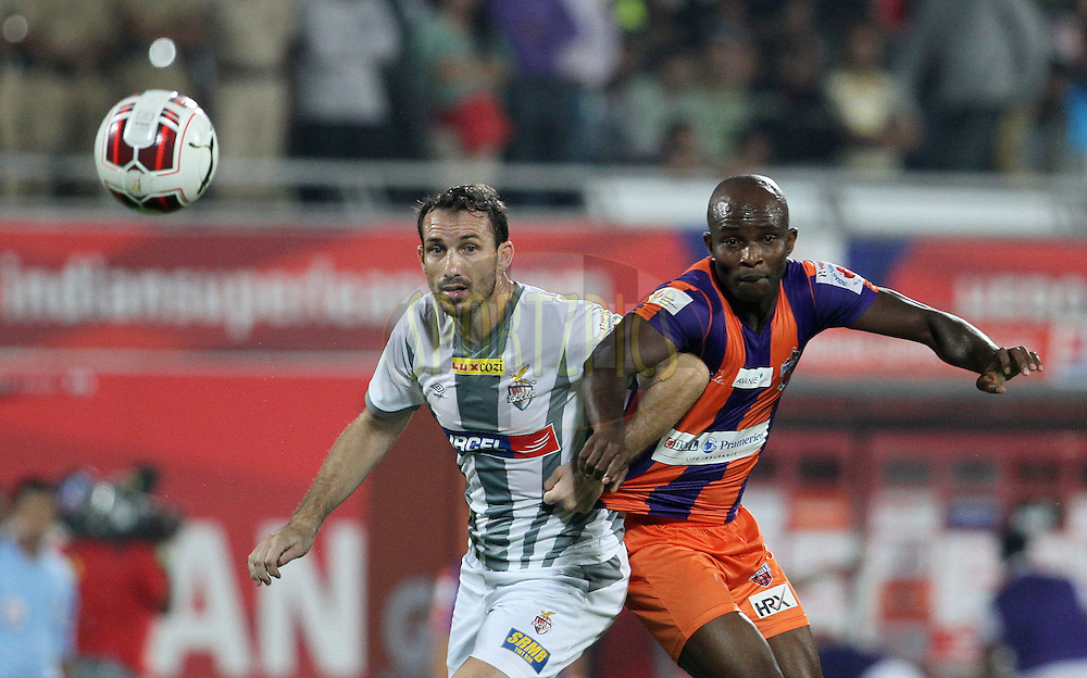 Jose Miguel Gonzalez Rey of Atletico de Kolkata and MacPherlin Dudu Omagbemi of FC Pune City in action during match 44 of the Hero Indian Super League between FC Pune City and Atletico de Kolkata FC held at the Shree Shiv Chhatrapati Sports Complex Stadium, Pune, India on the 29th November 2014.<br /> <br /> Photo by:  Vipin Pawar/ ISL/ SPORTZPICS