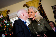 Sen. John McCain (R-AZ) kisses his wife Cindy at a campaign house party in Londonderry, NH, on Monday, Dec. 31, 2007.