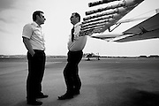 Two pilots talk waiting for the go ahead for the days flight paths. Image © Angelos Giotopoulos/Falcon Photo Agency