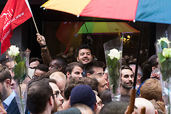 """Old Compton Street, Soho, London, June 13th 2016. Thousands of LGBT people and their friends converge on Old Compton Street in London's Soho to remember the fifty lives lost in the attack on gay bar Pulse in Orlando, Florida. PICTURED: A man leads chants proclaiming """"we are not afraid""""."""