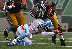Sept 27, 2009; East Rutherford, NJ, USA; New York Jets running back Tony Richardson (49) is tackled by Tennessee Titans linebacker Keith Bulluck (53) during the first half at Giants Stadium.