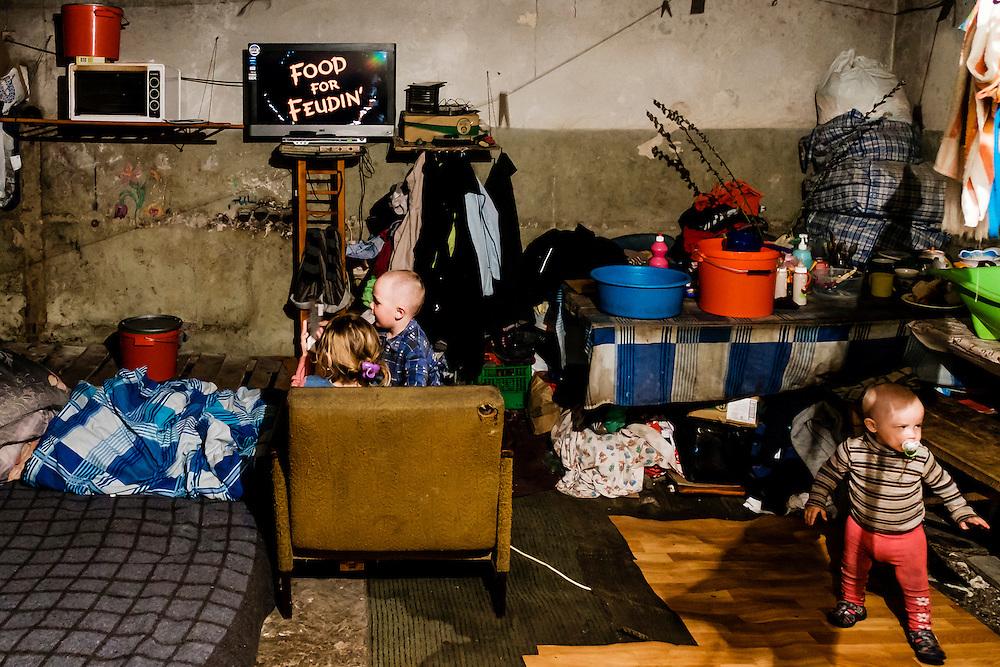 12 of April 2015 / Petrovski/ Donetsk Oblast/ Ukraine - Kids watching cartoons in a room inside the bunker.