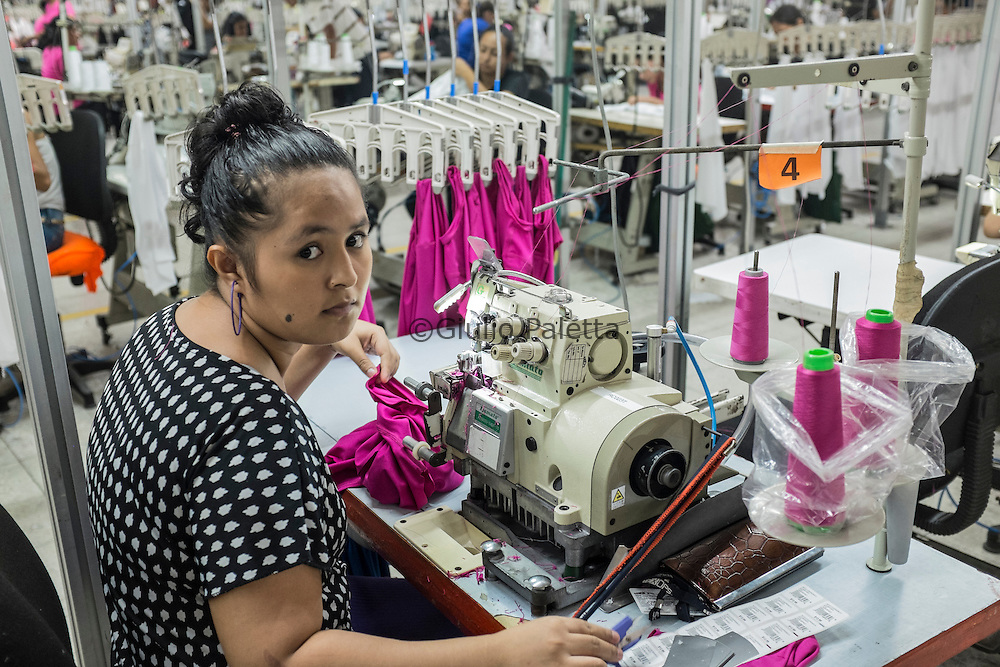 Workers inside the TexOps factory, around 40 minutes by car from San Salvador. Famous factory in El Salvador, TexOps produces sport and yoga clothes for famous brands around the world, in particular in Italy and USA. There are around 1250 people working here in this factory