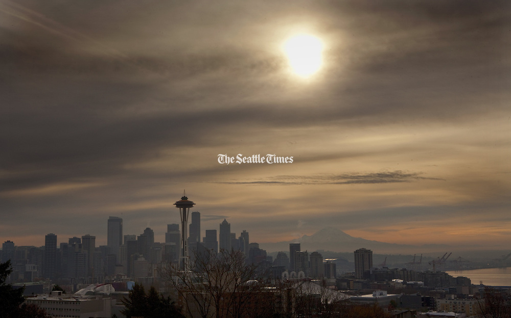 Hazy skies hang above Seattle in the morning as Mt. Rainier looms in the background.<br />