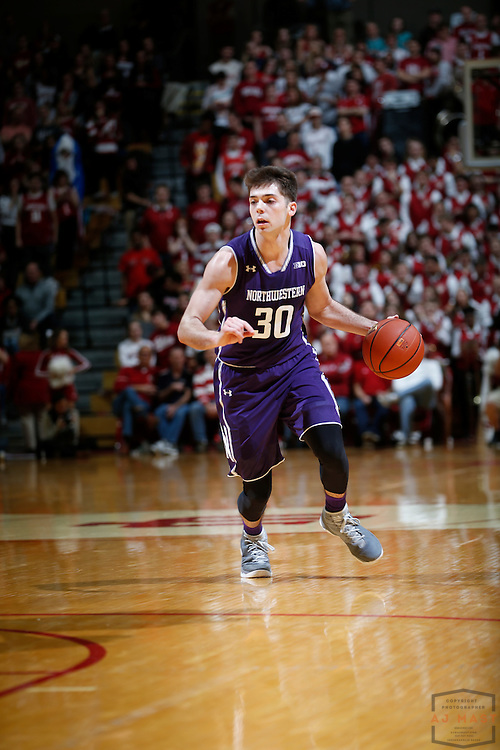 Northwestern guard Bryant McIntosh (30) in action as Northwestern played Indiana in an NCCA college basketball game in Bloomington, Ind., Saturday, Feb. 25, 2017. (AJ Mast)