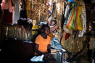 A young unaccompanied girl sits on the bed she shares with 3 other girls at the Yida refugee camp. The Lost boys of Sudan may be the best known example of the horror of Sudan's civil war, a conflict that was supposed to end with the independence of the South last July.  Countless South Sudanese boys were forced to flee, separated from their families, walking for days and weeks across hostile lands to the relative safety of a refugee camp. Many died on the way. .Now, this story is repeating itself as thousands of children, separated from their families by constant bombardment, starvation and battles are fleeing the same unresolved conflict, this time in the Nuba mountains of Sudan, where the Khartoum government has been at war with it's own people for over a year. The Sudan government's endless bombing campaigns of civilian targets like schools, churches, markets and boreholes has divided up families and separated children from their parents, and orphaned others..Over 3000 of these children have ended up at the Yida refugee camp, a controversial refuges for the Nuban people close to the North South border that the UN refuses to recognize as a camp for fear of being seen as supporting the rebels. The children have horrific stories. 20 year old John first lost his family in a bombing, he then lost his two younger brothers to starvation, without even the energy to bury them, he walked south for days until he arrived in Yida. 12 year old Rose fled with her entire boarding school after it was bombed and many of here fellow students and teachers killed. Robert watched his family stoned to death after a desperate group of refugees was ambushed by a Northern militia on the border..A few volunteer caretakers and teachers tend to the children. 22 year old Jamina who was separated from her own mother for 11 years during the last war. Today she watches over 500 girls in the same position. Packed into grass huts they built themselves the children try to study, and play and forget