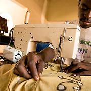 Men use sewing machines to make clothes at the Village Artisanal de Ouagadougou, a cooperative that employs dozens of artisans who work in different mediums, in Ouagadougou, Burkina Faso, on Monday November 3, 2008..