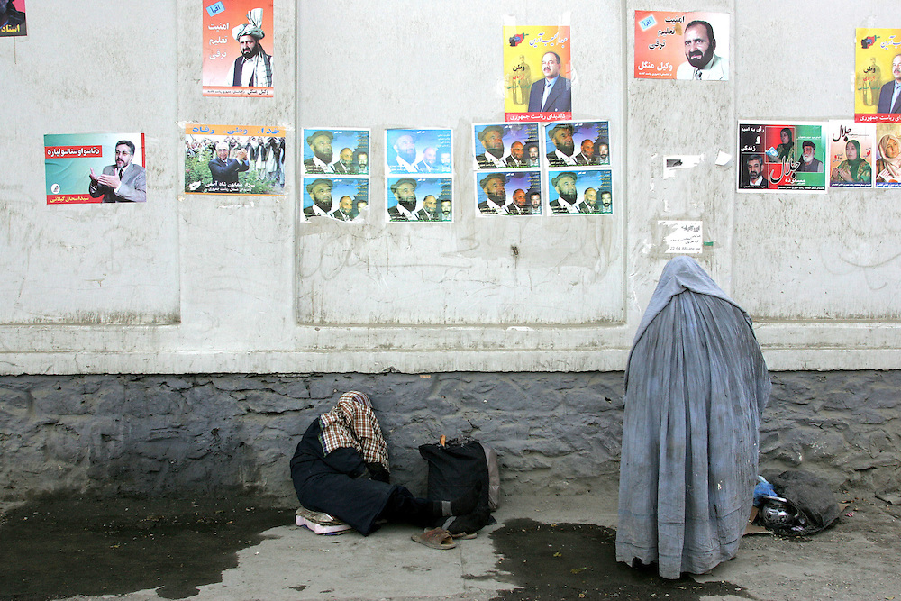 A woman wearing a Burka looks at election posters on the street in Kabul, Afghanistan.<br />