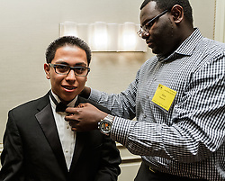 IRVINE, CA - MARCH 2:  Students from different high schools in southern california get finishing touches after getting fitted with tuxedos donated by the Mens Wearhouse at the Working Wardrobes Dream Girls & Distinguished Gentlemen 2013 event at the Irvine Hilton in Irvine, CA. Working Wardrobes (http://www.workingwardrobes.org) is a non-profit organization located in Costa Mesa, CA. PHOTO: © 2013 SILVEX.PHOTOSHELTER.COM.
