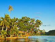 Deck and hanging chaise lounge on coast at Matangi Private Island Resort, Fiji.