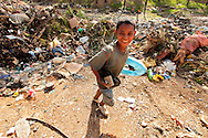 A youngster leaves the dump after sifting through the garbage at the dump in Crematorio, Honduras looking for things he can sell, eat or wear. Honduras is considered the third poorest country in the Western Hemisphere (Haiti, Nicaragua). With over 50% of the population living below the poverty line and 28% unemployed, Hondurans frequently turn to illegal immigration as a solution to their desperate situation. The Department of Homeland Security has noted an 95% increase in illegal immigrants coming from Honduras between 2000 and 2009, the largest increase of any country.