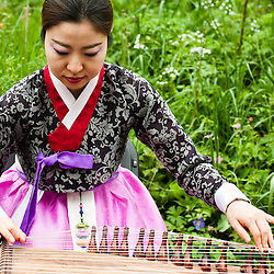 LONDON, UK - 21 May 2012: musical performance at the Korean DMZ Forbidden Garden during the RHS Chelsea Flower Show 2012.