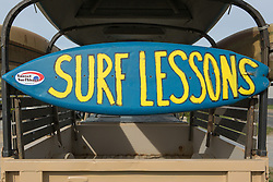 surf lesson sign on a surfboard in Montauk, NY