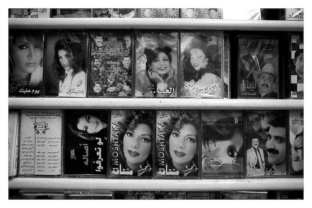 Pictures of arabic singers on the covers of cassettes in a music shop in the Old City of Jerusalem. Israel, 2006