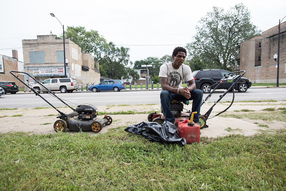 Jacoryon Sorrelles takes a break from his landcaping job at a site in Englewood. Vacant lots are a common site on South Halsted; Sorrelles says that a majority of sites he mows in the city are like this one on Halsted which are vacant lots up for sale.