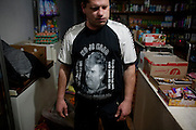 Uros Popovic in a Velika Hoca shop where we drink Macedonian beer. He is wearing his favorite Radovan Karadzic t-shirt...Orthodox Christmas (January 7) in the Serbian village of Velika Hoca, Kosovo.