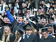 "Graduates chant the school's ""Hotty Toddy"" cheer at the conclusion of the University of Mississippi graduation ceremony in Oxford, Miss. on Saturday, May 11, 2013. (AP Photo/Oxford Eagle, Bruce Newman)"