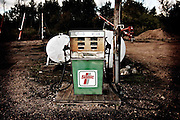 Gas tanks used for fueling farm equipment sit near augers in a farmyard near Birch Hills, Saskatchewan.
