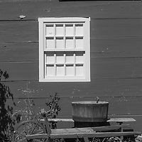 Wooden Cart and Bucket on a bench under a window.