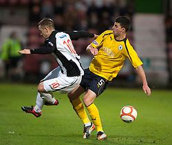 Dunfermline's Ryan Wallace and Falkirk's Jonathan Flynn..Dunfermline 0 v 1 Falkirk, 26/12/2012..©Michael Schofield.