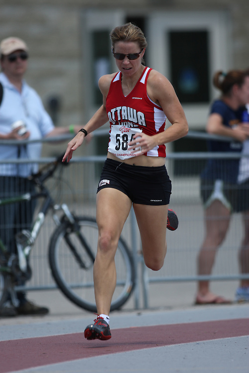 (London, Ontario---14/06/09)   Noella Klawitter of Ottawa Lions T.F.C. competes in the  200m at the 2009 Athletics Ontario Junior Track and Field Championships. The meet was held in London, Ontario from June 13-14, 2009. Copyright photograph Sean Burges / Mundo Sport Images, 2009. www.mundosportimages.com / www.msievents.