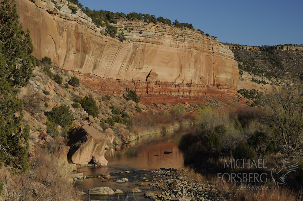 High Plains, shortgrass prairie region..Kiowa National Grassland, New Mexico...Late afternoon light warms up the towering walls of Mills Canyon along the Canadian River, which has carved its way nearly a 1000 feet below the flat treeless high plains on the canyon rim..