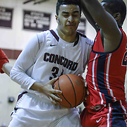 Concord Raiders Forward Joseph McHugh (31) drives towards the basket as Plymouth Whitemarsh Forward Carneron Johnson (24) defends in the first half of a regular season non-conference high school basketball game between the Plymouth Whitemarsh Colonials and Concord High Raiders Monday, Jan. 19, 2015 at Concord High School in Wilmington, DEL