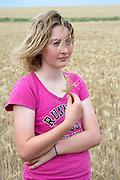 12 year old Pippa Reilly on her family's wheat field (paddock), Wyalkatchem, Western Australian Wheatbelt. 09 December 2012 - Photograph by David Dare Parker