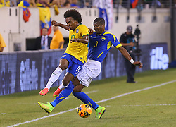 Sep 9, 2014; East Rutherford, NJ, USA; Brazil midfielder Willian (19) and Ecuador defender Frickson Erazo (3) play the ball during the first half at MetLife Stadium.