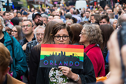 Old Compton Street, Soho, London, June 13th 2016. Thousands of LGBT people and their friends converge on Old Compton Street in London's Soho to remember the fifty lives lost in the attack on gay bar Pulse in Orlando, Florida. PICTURED: A woman's placard sends a message of love and solidarity from London to Orlando.