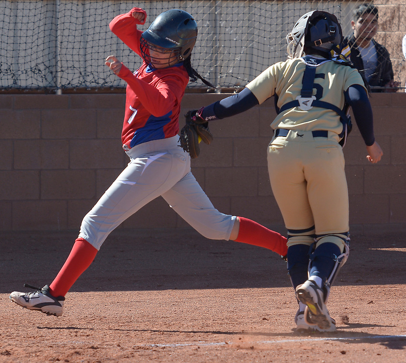 gbs040417i/SPORTS -- Atrisco Heritage catcher Jaelynn Vialpando tags out West Mesa's Eva Perez, 7 ,  in the first inning of the game at West Mesa on Tuesday, April 4, 2017. (Greg Sorber/Albuquerque Journal)