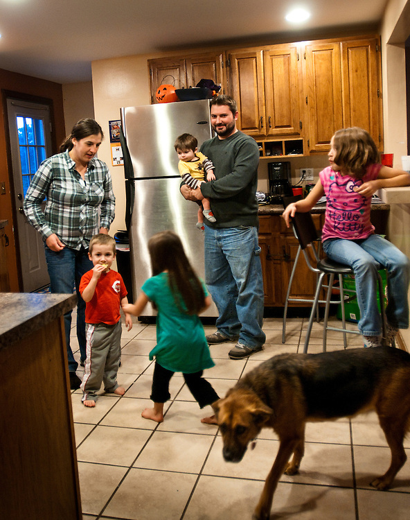 The Cross family in their kitchen, which they built from things they got on Craigslist. A friend gave them the refrigerator...From left:  Beth 31, Adam 3, Abby 4, Zak 11 months, Kyle 31, Rilee 8 and Philly the dog
