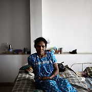 30 year old surrogate mother Saroj Machwan seen at the Akanksha Infertility and IVF Clinic in Anand, Gujarat, India. The centre has become the most popular clinic for outsourcing pregnancies by western couples.