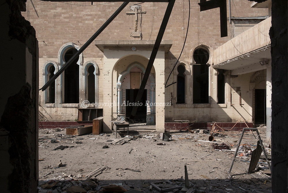 Iraq, Mosul: the damaged by airstrikes courtyard of Um Al Maonna church in west Mosul. Alessio Romenzi