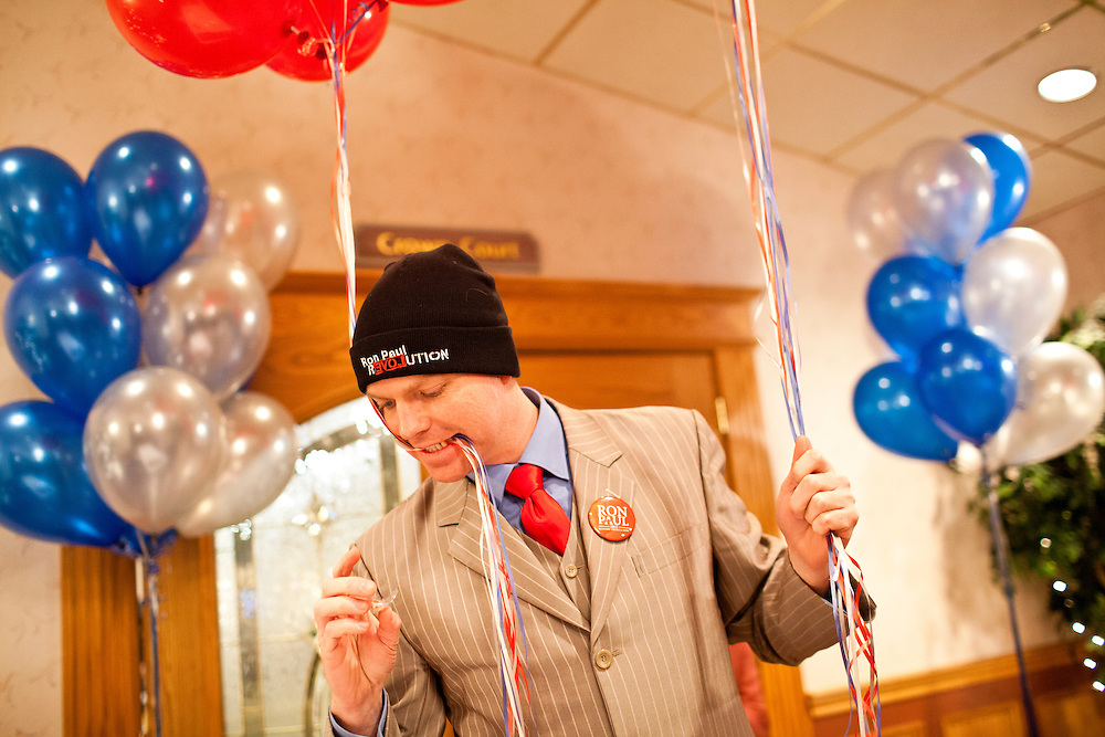 Chris Gosselin, a volunteer for the campaign of Republican presidential candidate Ron Paul, preps balloons for a primary night rally at the Executive Court banquet facility on Tuesday, January 10, 2012 in Manchester, NH. Brendan Hoffman for the New York Times
