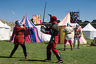 McG0064278<br /> Re-enactors perform at Portchester Castle in Hampshire to mark the 600th anniversary of the battle of Agincourt. <br /> In 1415 soldiers left from the castle, now managed by English Heritage, for northern France where they went on to face the French in a muddy farmer's field.<br /> Picture date: Saturday August 8, 2015.<br /> Photograph by Christopher Ison &copy;<br /> 07544044177<br /> chris@christopherison.com<br /> www.christopherison.com