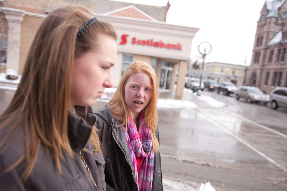 Woodstock, ONT.; December 9, 2010-- Woodstock, Ontario high school students Rachel Moodie, 14, left, and Liv Marsh, 15 react to finally hearing the verdict in the case of Terry-Lynne McClintic who pleaded guilty in April, 2010 to first degree murder in the death of  8 year old Victoria Stafford but the verdict was kept under a sweeping publication ban until it was lifted by the Supreme Court December 9, 2010. <br /> <br /> (GEOFF ROBINS/ Postmedia News)