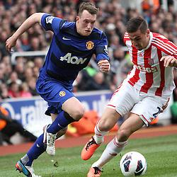 Manchester United's Phil Jones and Stoke City's Geoff Cameron (c) Phil Duncan | StockPix.eu